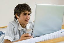 Young boy using laptop
