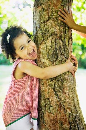 Toddler hugging a tree